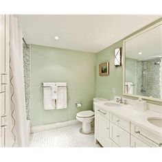 Soothing pale green and white bathroom, with touches of silver/chrome.