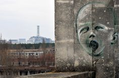 Graffiti adorns a wall April 4 in the ghost city of Pripyat near the fourth nuclear reactor (background) at the former Chernobyl Nuclear power plant, site of the world's worst nuclear disaster. (Sergei Supinsky/AFP/Getty Images)