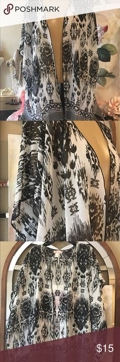 "Band of Gypsies Sheer Kimono Medium Large 🆕 Band of Gypsies size medium/large black and white print sheer open front Kimono. Very generously sized. 34 1/2"" shoulder to hem, arm opening 12"" wide, about 34"" wide. It's kind of hard to measure the width. 💯 polyester. In great condition not worn. Band of Gypsies Tops Tees - Short Sleeve"