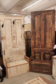 Old doors being fashioned into benches with coat hooks.