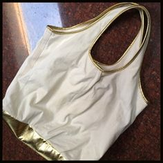 Gold-trimmed Casual Tote Gold-trimmed Casual Tote- casual but dressed up go anywhere tote is roomy enough to throw in all your necessities- including my small tablet and sweater for cooler temps. Boutique Bags Totes