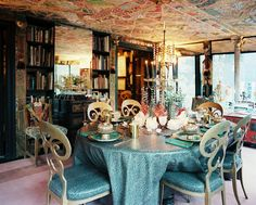 Dining Room Photo - Snakeskin-printed vinyl tablecloth and chair cushions paired with gold chair frames