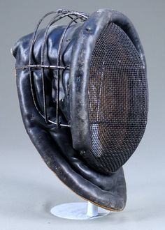Interesting vintage fencing mask... possibly reinforced for sabre head cuts...