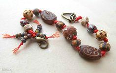 Knotted bracelet with Czech glass and bone beads www.lilrubyjewelry.com