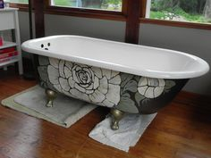 restored vintage cast iron clawfoot tub by paintintheair