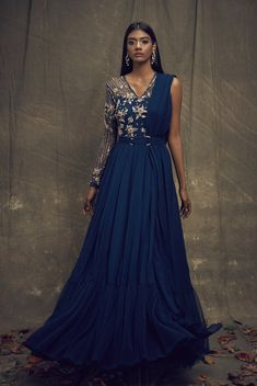 Teal georgette one-shoulder draped anarkali with gold hand embroidery and a pleated net hem paired with a gold metallic belt Indian Gowns Dresses, Indian Fashion Dresses, Indian Designer Outfits, Pakistani Gowns, Fashion Outfits, Designer Party Wear Dresses, Designer Gowns, Desi Wedding Dresses, Indian Bridal Outfits