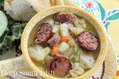 Cajun Cabbage Stew - a stew of ground pork or beef, andouille sausage, cabbage, the trinity of onions, bell pepper and celery, potatoes and carrots, in a chicken or beef broth base with Rotel tomatoes.