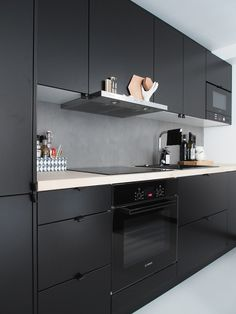 Dark small kitchen in Turku, Finland.