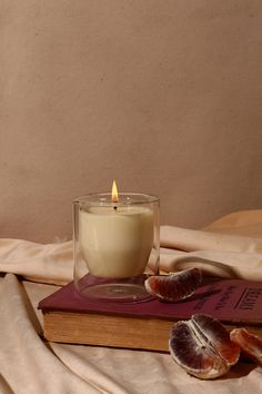 Inspired by Avilés street in Saint Augustine, Florida, a picturesque cobblestone road that is lined with blooming jasmine in the spring and bright, floral notes of the citrus fill the air.Notes of Jasmine, Blood Orange + White MuskMateri. Soy Candles, Scented Candles, Candle Jars, Parfum Cartier, Foto Still, Photo Candles, Candels, Glass Vessel, Still Life Photography