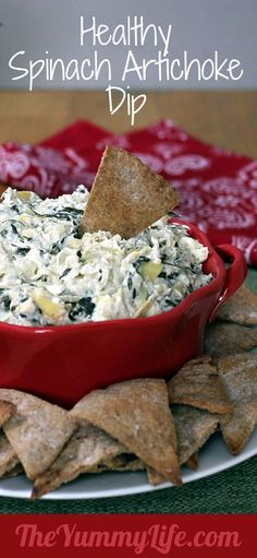 Healthy Spinach Artichoke Dip. An easy, creamy, low calorie makeover in the slow cooker or oven. TheYummyLife.com