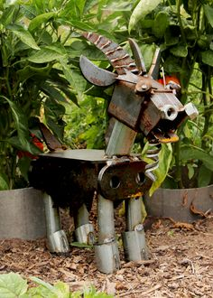 Angry Goat guards with vegetables with fevor, but you needn't worry: He won't snatch a bite. Made of scrap metal.
