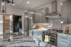 Modern Kitchen with Undermount sink, One-wall, Dura Supreme Cabinetry Ava Panel, Cambria - seagrove, Herringbone Tile, Flush