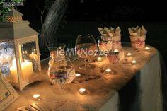 http://www.lemienozze.it/operatori-matrimonio/wedding_planner/organizzazione-cerimonie-roma/media/foto/11  Luci e confetti per il ricevimento matrimonio