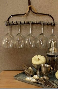 ~garden rake used as a wine glass holder~cute idea for a country kitchen or wine bar~