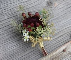 Burgundy, green, and gold dahlia boutonniere.