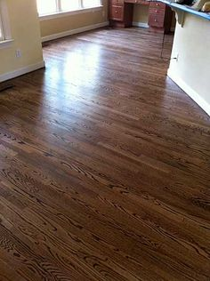 Oak floors with dark walnut stain against simple white trim, love the wall color (painted bead board)--The paint color is Sherwin Williams Sand Beach Flat. Exterior Wood Stain Colors, Hardwood Floor Stain Colors, Minwax Stain Colors, Walnut Hardwood Flooring, Oak Flooring, Modern Flooring, Oak Floor Stains, Red Oak Floors, Wood Floor Bathroom
