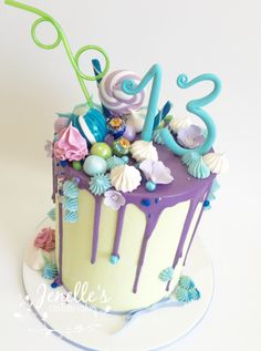 Green and purple drip cake. By Jenelle's Custom Cakes!