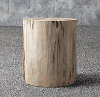 RH's Petrified Wood Outdoor Round Side Table:Though crafted from 25-million-year-old tree fossils, our table is uniquely contemporary. Each is cut from a one-of-a-kind piece of petrified wood, which formed millions of years ago when a prehistoric forest was blanketed in volcanic ash. Over time, the organic material of the trees was replaced by minerals, resulting in a stone fossil. Each piece highlights the complex internal structure of the tree and the subtle drama of the stone's...