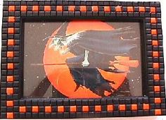 Sarah Harrington Lajoie designed this easy-to-make Halloween MIni Mosaic Picture Frame using handmade miniature mosaic tiles. From our free pcPolyzine archives October 2001.  www.pcpolyzine.com/october2001/frame.html