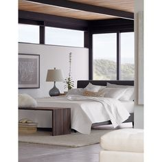 """Our 1960s-inspired Tate collection recalls the timelessness of mid-century design with tailored profiles and streamlined shapes. The bed's textural upholstery is punctuated with retro button-tufting on the headboard. Streamlined, low platform design takes a minimal stance with dark brown tapered legs.<br><br>Needs some inspiration? Check out our <a href=""""/ideas-and-advice/bedroom-furniture-decor-ideas"""">bedroom furniture ideas.</a><br><br><NEWTAG/><ul><li>Frame is benchmade with certified…"""