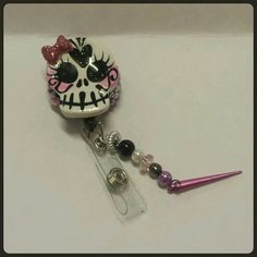 Check out this item in my Etsy shop https://www.etsy.com/listing/218996218/sugar-skull-badge-reel