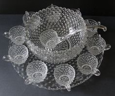 """Duncan Miller Clear Hobnail Pressed Glass Punch Bowl Set with Underplate. Bowl, 9-3/4"""" x 5½"""" tall. Tray/plate 17"""" diam. 10 cups, 1 ladle. $349.95 on etsy"""