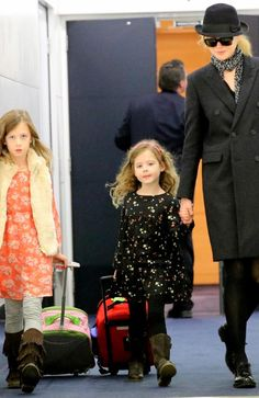 Nicole Kidman with daughters Sunday Rose and Faith Margaret at Sydney airport. Picture: Stephen Cooper