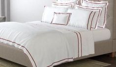 Ansonia by Matouk shown in Chinese Red.Exceptionally woven 500 thread count white percale from the finest Egyptian cotton is finished with two elegant rows of satin embroidery for a collection t