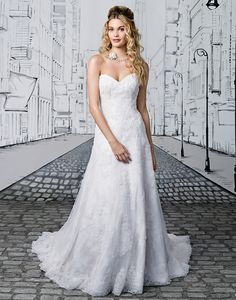 �Pearl beading that is swoon worthy. Scattered pearl appliques adorn the sweetheart neckline and continue throughout this A-line gown. Further show off your waist with the addition of sized belt style 8891B. https://www.justinalexanderbridal.com/wedding_dresses/8891