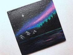 Galaxy night scene painted on a 4x4 canvas panel. Comes with a white mini easel