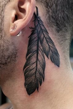 behind the ear feather tattoo. Wouldn't have it behind my ear but like the design.