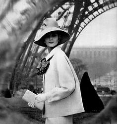 Model in white linen suit, jacket is lined in black and white polka-dot silk, the same as the blouse underneath, by Nina Ricci, photo by Guy Arsac, Paris, 1963