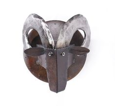 Make a statement with this handmade wall sculpture. It is made by Ben Gatski with reclaimed farm metal. Ram's Head by TheSteelFork on Etsy https://www.etsy.com/listing/44910489/art-metal-wall-sculpture-rams-head