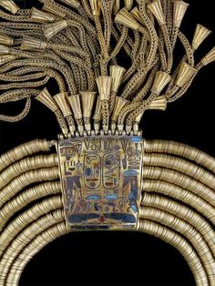A close up view of the necklace that belonged to Pharaoh Psusennes I, from the treasures of Tanis