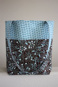 Perfect diaper bag!  Simple, plenty of pockets, and it doesn't look like a diaper bag!!!