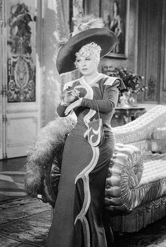 "Still image from ""Every Day's A Holiday"", 1937,  Mae West gown a costume designed by Schiaparelli"