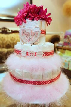 Diaper cake at a pink and gold baby shower party! See more party planning ideas at CatchMyParty.com!
