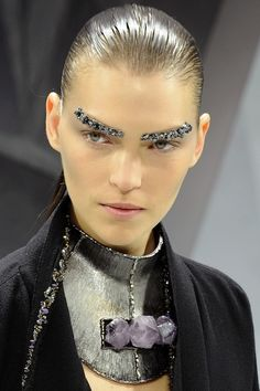 Last season the beauty look consisted of pearl nose rings, this season it was all about glitter eyebrows... umm..?