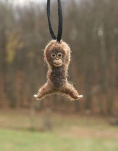 Tiny Orangutan Necklace  needle felted by motleymutton on Etsy