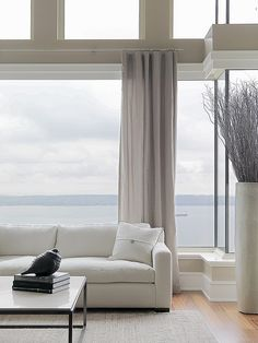 Natural tones - spansive windows - high ceiling - great view