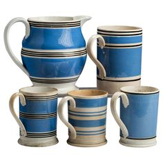 Collection of 19th Century Blue and White Staffordshire Mochaware Pottery - A collection of five 19th century blue, black and white stripe-decorated Staffordshire mochaware pottery, comprising a slip-banded jug, quart mug and three pint mugs, English, circa 1840-1880.