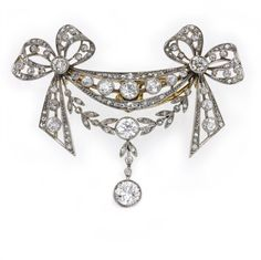 Edwardian diamond brooch, the brooch comprising two ribbon bow motifs linking a swag and foliate garland, with a diamond-set drop to the centre, set throughout with rose-cut and old brilliant-cut diamonds, estimated to weigh a total of 3 carats, all set in silver to a yellow gold mount in an openwork design, measuring approximately 5x4cm, gross weight 11.2 grams, circa 1900