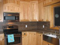 dark tile backsplash in the kitchen