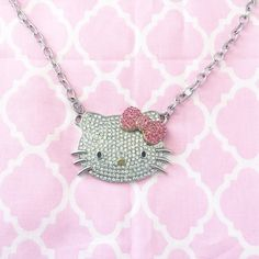 Hello Kitty Necklace Be a cutie with this Hello Kitty rhinestone necklace. <3 For size reference, see photo. :) excellent condition, like new. Hello Kitty Jewelry Necklaces