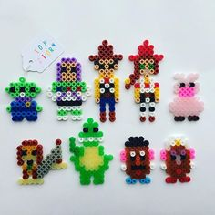 Toy story characters hama beads by pumpkinpiemakes perler bead disney, perl Hama Beads Design, Diy Perler Beads, Perler Bead Art, Pearler Bead Patterns, Perler Patterns, Perler Bead Disney, Pearl Beads Pattern, Peler Beads, Pixar