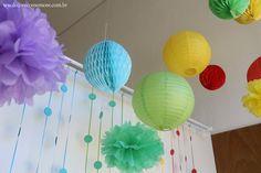 Festa Divertida Mente by Decore & Comemore // Mesa decorada papelaria e peças nas cores de cada personagem. Personagens e peças disponíveis para locação. Pom pom em papel de seda, lanternas japonesas em papel e honeycomb.