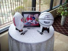Have guests sign football or basketball at welcome table for a cute wedding keepsake....LOVE this idea, too bad it doesn't go with my theme :(  lol