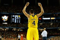 Michigans Mitch McGary watches his team from the bench during second half action between Michigan and Syracuse in the NCAA Final Four on Saturday April 6, 2013.