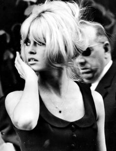 The bardot bang and little side wisps again -- and I'd take that scoop-neck peter pan collar dress while we're at it.