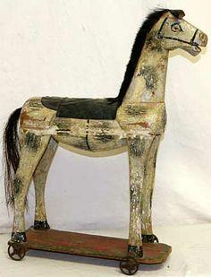 FOLK ART HORSE PULL TOY. American. Circa 1850-1870s. / Charles L. Flint